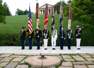 The Army Old Guard color guard stands watch during a wreath laying ceremony, at the grave of former President John F. Kennedy, to mark the 100th anniversary of his birth, at Arlington National Cemetery in Arlington, Va., Monday, May 29, 2017. Kennedy was born May 29, 1917. (AP Photo/Cliff Owen)